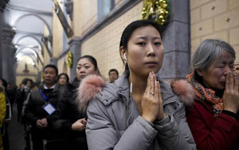 beijing catholics praying