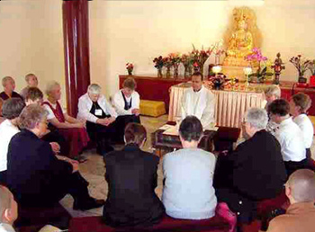 buddhists Catholic pray