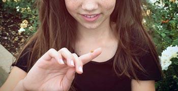 a ladybug land on a girls finger